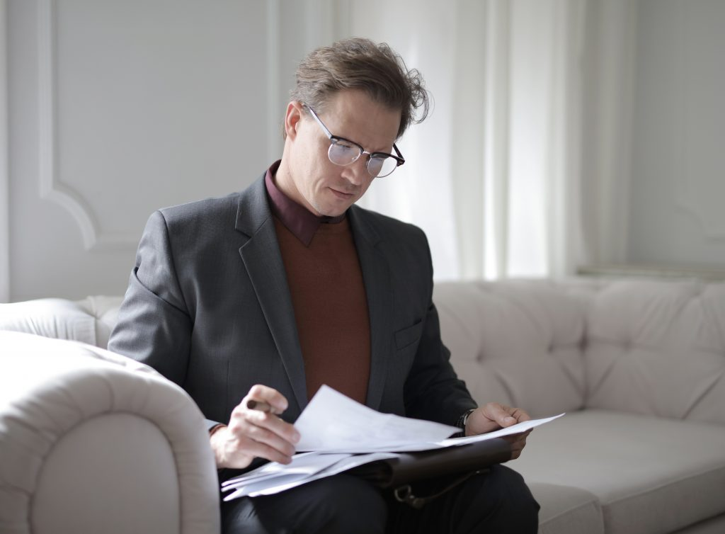 lawyer for wills and estate in Campbelltown looking through some papers