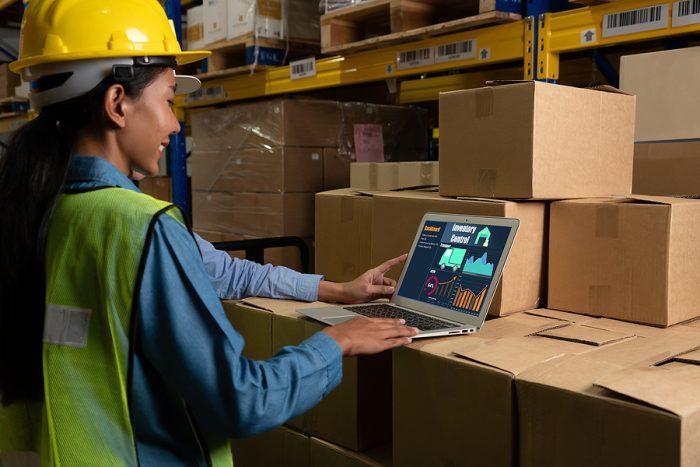Warehouse worker using MYOB Greentree system
